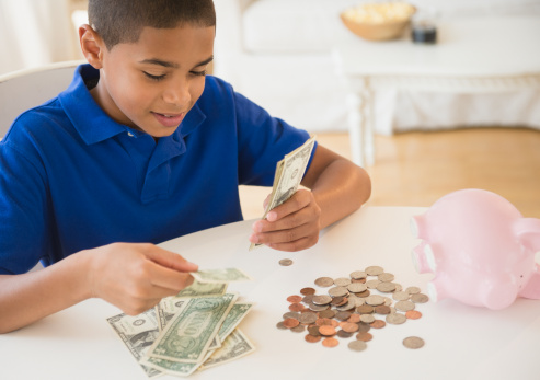 April is Financial Literacy Month: 7 Money Tips For Kids and Teens