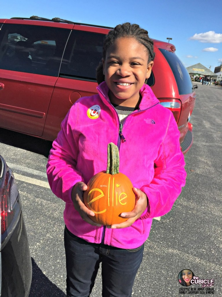 Eckert's farm carving pumpkins