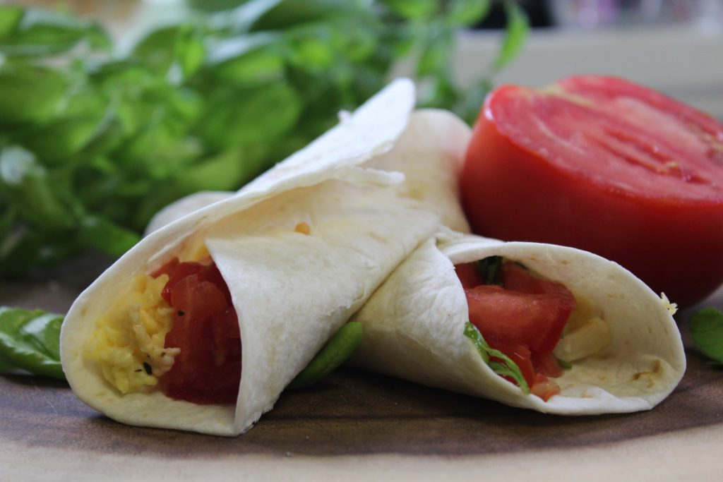 For busy families on the go, don't skip the most important meal of the day. Do breakfast on the go with these tomato basil breakfast burritos.