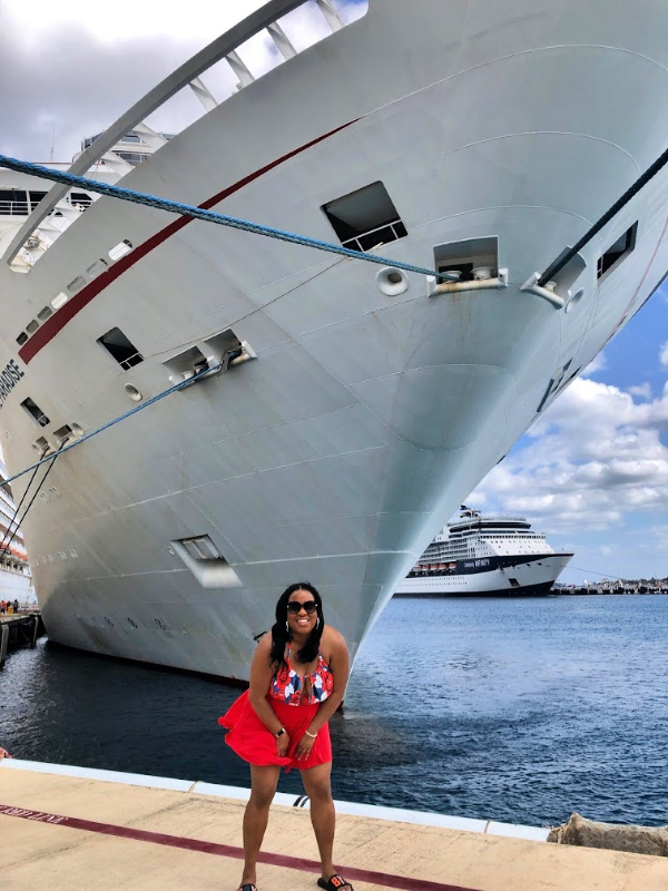 Black woman in front of cruise ship at Cozumel Port