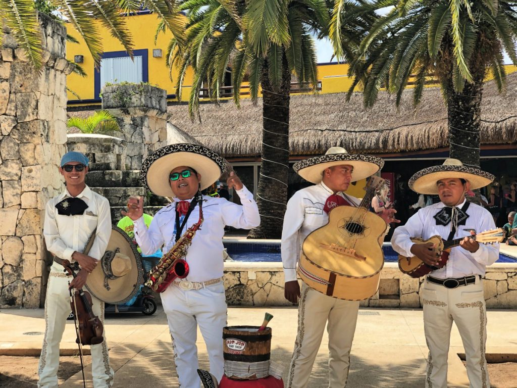 Four piece band playing in Cozumel Plaza