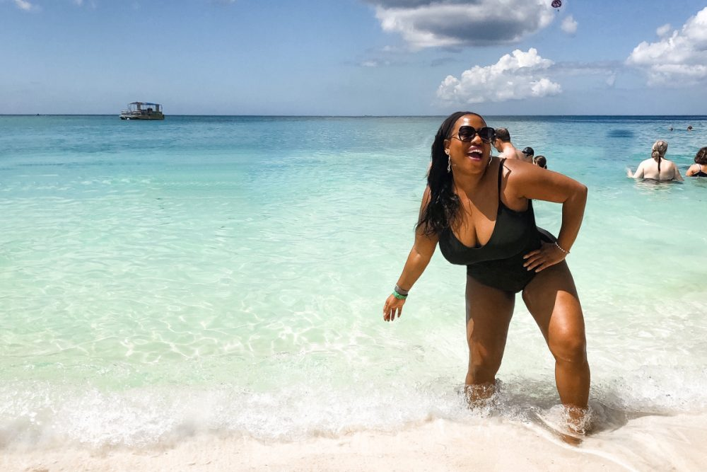 Black woman in bathing suit on 7 Mile Beach Grand Cayman