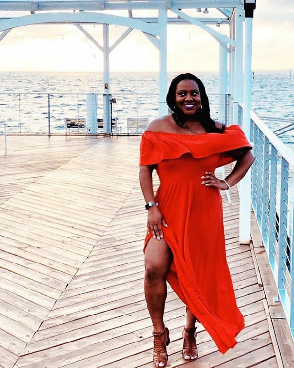 Black woman wearing red dress at The Godfrey Hotel and Cabanas Tampa Bay